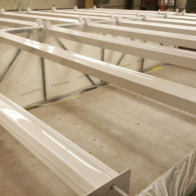 Heavy duty shelving horizontal beams refinished for American Polyfilm Inc.