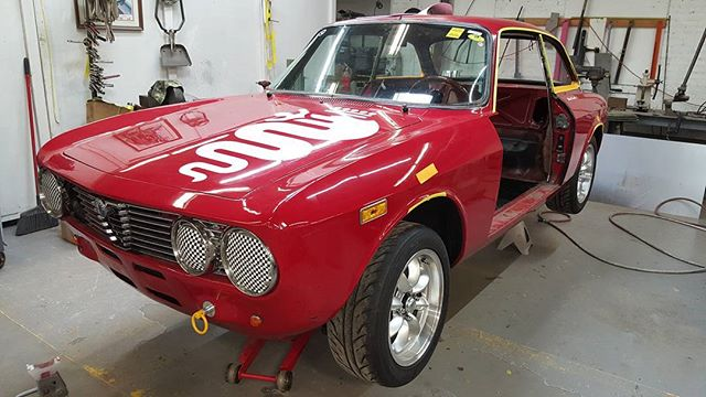 Roll cage and panhard bar on deck for this Alfa